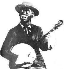 Ecco l'immagine classica dell'Afro-Americano nei Minstrels Show,accompagnato dal suo strumento tipico,il Banjo.