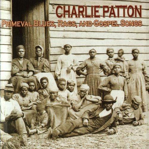 Una foto ,copertina di un c raccolta delle incisioni di Patton, con una foto originale dei braccianti agricoli sul delta del Mississippi alla fine del 1800.