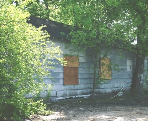 Questa baracca è molto simile a quella abitata da Johnson  in Young Street a Baptist Town nel 1938.