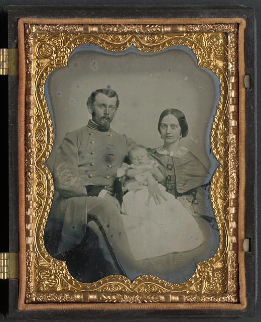 nidentified officer in Confederate uniform with wife and baby] 1863